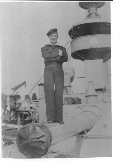 Knut Andreas Einarsen proudly standing on the Norwegian battleship Norge  in 1965.  The ship was sunk by the Germans during their invasion of Norway in April 1940.  (Photo belongs to Knut and Haldis Einarsen)